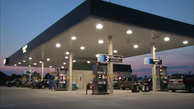 Medium Long Shot static - LED lamps illuminate a gas station /  Wisconsin, United States