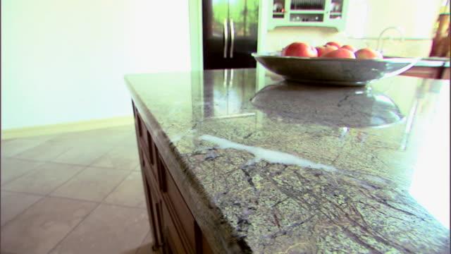 Medium move right across a kitchen with a granite countertop.