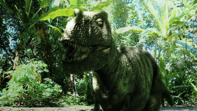 Medium pan-left push-out - A dramatization shows a Tyrannosaurus Rex running through a jungle. / Chicago, Illinois, USA