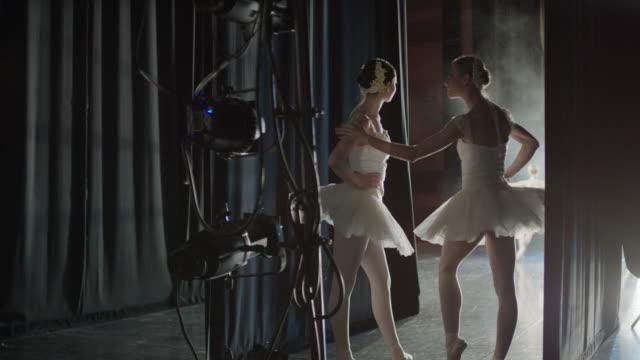 Medium panning shot of ballerinas waiting backstage / Salt Lake City, Utah, United States