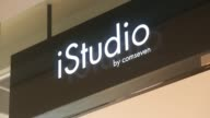 Medium shot an Apple Premium Seller logo is displayed above the entrance to an iStudio store in Bangkok Thailand Medium shot logo for an iStudio...