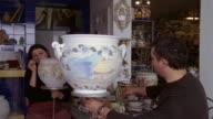 Medium shot artisans painting ceramic vases in workshop in Praiano / Amalfi Coast, Campania, Italy