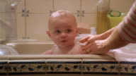 Medium shot baby getting bathed