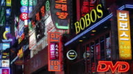 Medium shot Bobos Bar and other neon street signs in Insa Dong district at night / Seoul, South Korea
