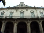 Medium shot building with arches/ Havana, Cuba