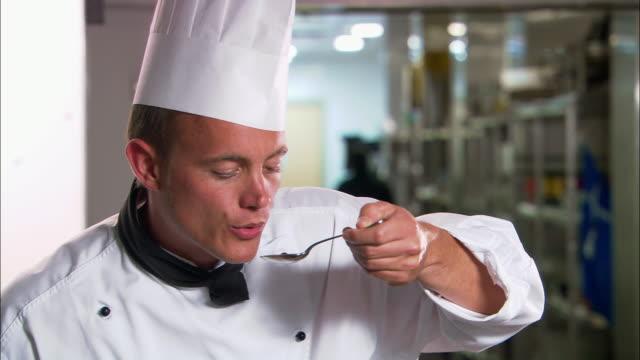Medium shot chef tasting sauce or stock / Auckland, New Zealand