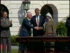 1993 medium shot Clinton standing behind Arafat and Rabin shaking hands / Washington DC
