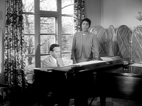 Medium shot Contralto singer Marian Anderson and her pianist rehearsing in her home studio/ Danbury Connecticut USA