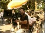 Medium shot dolly shot around cameramen, film cameras and film crew outdoors / Mexico City
