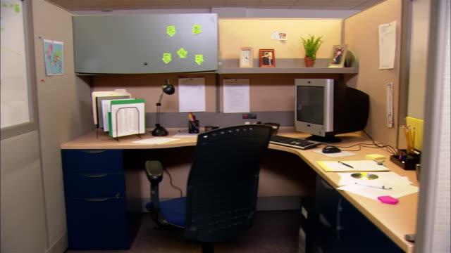 Medium shot dolly shot empty office cubicle