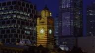 Medium shot Flinders Street Station clock tower at twilight/ Melbourne, Australia