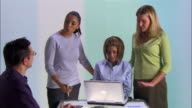 Medium shot four people having business meeting