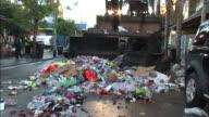 Medium Shot - Garbage truck moving trash down the street / New Orleans Louisiana