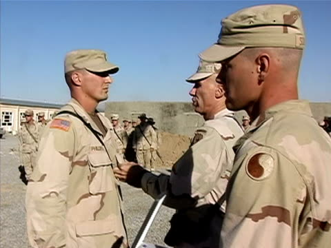 Medium shot general giving soldier award and medal US military base/ Afghanistan