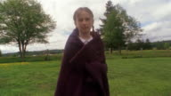 Medium shot Girl wearing blanket in field / Des Moines, King County, Washington, USA