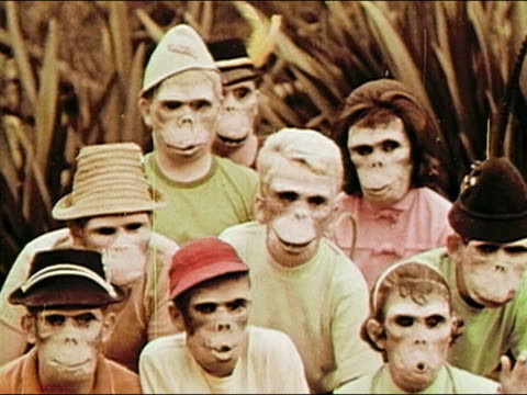 1963 medium shot group of kids wearing creepy ape masks / standing up and running off / revealing tails / AUDIO