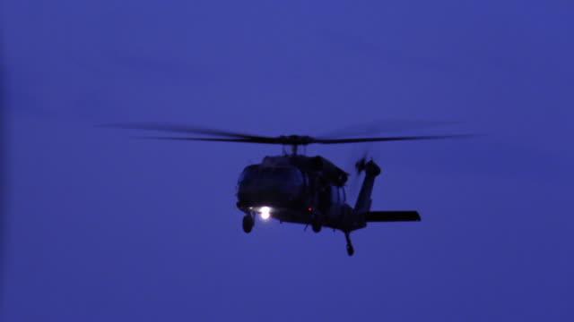 Medium shot helicopter flying at twillight