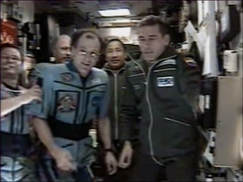 2003 medium shot Lu and Malenchenko posing with the ISS crew members Budarin Bowersox Pettit