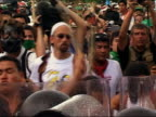 2003 medium shot male protesters at WTO meeting beating on cops with sticks / Cancun Mexico
