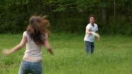 Medium shot man and woman playing frisbee