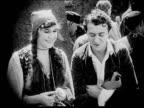 1916 B/W Medium shot man and woman talking and flirting