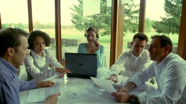 Medium shot men and women at business meeting/ Solebury, Pennsylvania