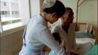 Medium shot nurse taking patient's blood pressure / Nepal