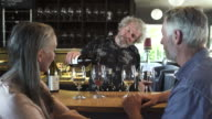 Medium shot of a couple tasting wine in a bar