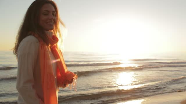Medium shot of carefree woman dancing on beach/Marbella region, Spain