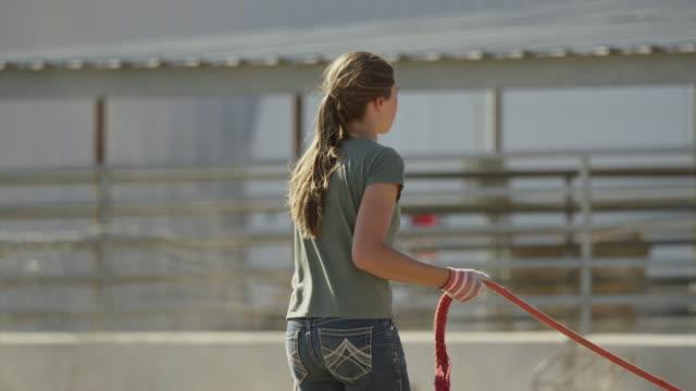 Medium shot of girl running horse in circle / Lehi, Utah, United States