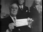 Medium shot of men with canvas sacks of dimes over their shoulders entering a White House door surrounded by soldiers and men in suits / Shots of...