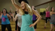 Medium shot of people dancing in exercise class / Orem, Utah, United States