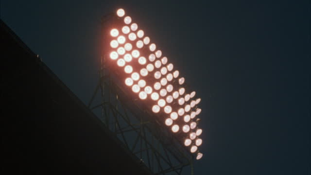 Medium shot of stadium lights.