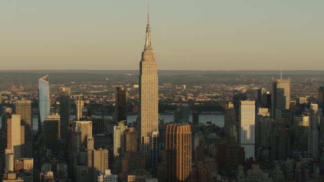 Medium shot of the Empire State Building in morning light with Midtown Manhattan in background