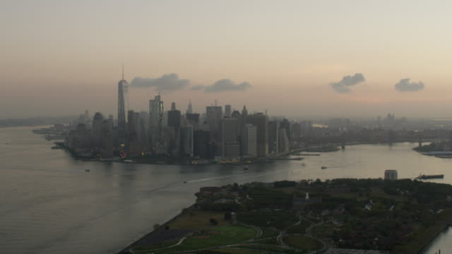 Medium shot of the Governors Island with the World Trade Center buildings and the Freedom Tower in the background