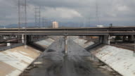 Medium Shot of the Los Angeles River and a freeway in Los Angeles