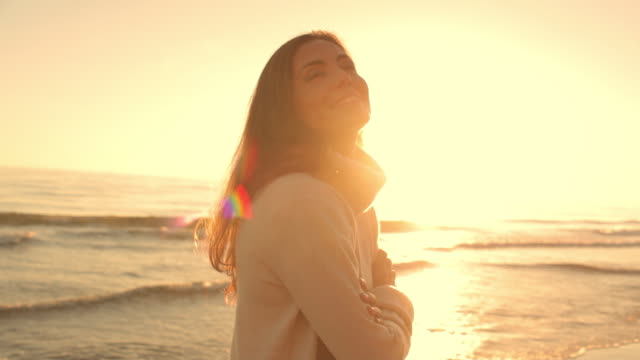 Medium shot of woman standing on beach/Marbella region, Spain