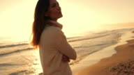 Medium shot of woman walking on beach/Marbella region, Spain