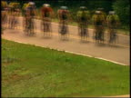 Medium shot pack of bicycle racers riding in line / Natchez, Mississippi