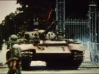 1975 medium shot pan Viet Cong riding into Saigon in a tank / AUDIO / Vietnam