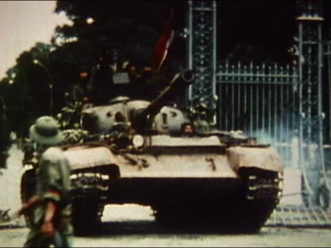 1975 medium shot pan Viet Cong riding into Saigon in a tank / AUDIO / Vietnam