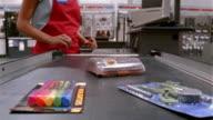 Medium shot point of view from items on conveyor belt at megastore/ California