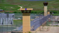 Medium shot prison guard towers