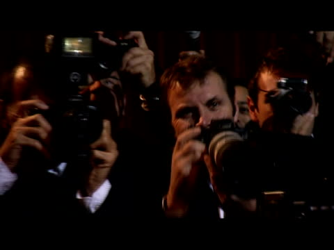 Medium shot reporters and paparazzi at on red carpet/ London