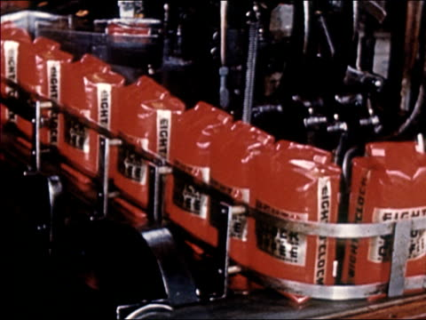 1954 Medium shot sacks of Eight O'Clock Coffee on moving on conveyor belt / AUDIO