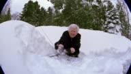 Medium shot senior woman scraping snow off of car
