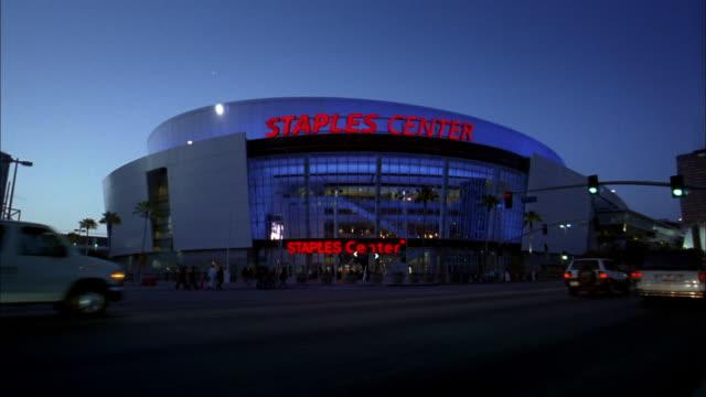 Medium shot Staples Center at night w/traffic in foreground