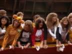 1982 medium shot teen girls with big hair singing at Beach Boys concert at Candlestick Park / San Francisco