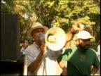 Medium shot three actors on set / swish pan to film director talking into bullhorn / PAN to cameras / Mexico