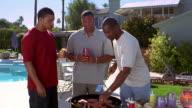Medium shot three Black men barbecuing outdoors / Arizona